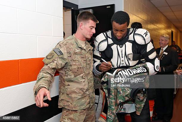 So Wayne Simmonds of the Philadelphia Flyers signs his camouflage jersey  for a member of the US 2016 ... f14aad01a