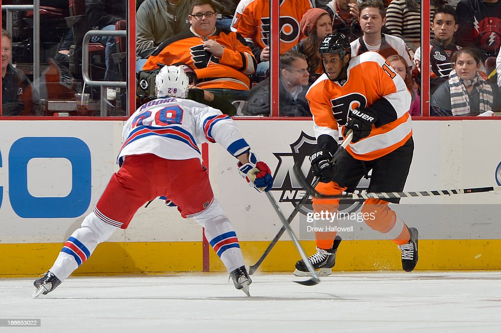 <a gi-track='captionPersonalityLinkClicked' href=/galleries/search?phrase=Wayne+Simmonds&family=editorial&specificpeople=4212617 ng-click='$event.stopPropagation()'>Wayne Simmonds</a> #17 of the Philadelphia Flyers skates against the New York Rangers at the Wells Fargo Center on October 24, 2013 in Philadelphia, Pennsylvania.