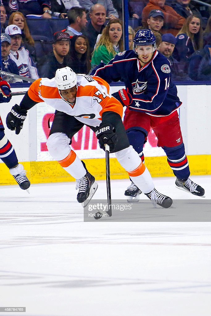 <a gi-track='captionPersonalityLinkClicked' href=/galleries/search?phrase=Wayne+Simmonds&family=editorial&specificpeople=4212617 ng-click='$event.stopPropagation()'>Wayne Simmonds</a> #17 of the Philadelphia Flyers skates the puck up ice away from <a gi-track='captionPersonalityLinkClicked' href=/galleries/search?phrase=Blake+Comeau&family=editorial&specificpeople=879782 ng-click='$event.stopPropagation()'>Blake Comeau</a> #14 of the Columbus Blue Jackets during the third period on December 21, 2013 at Nationwide Arena in Columbus, Ohio. Columbus defeated Philadelphia 6-3.