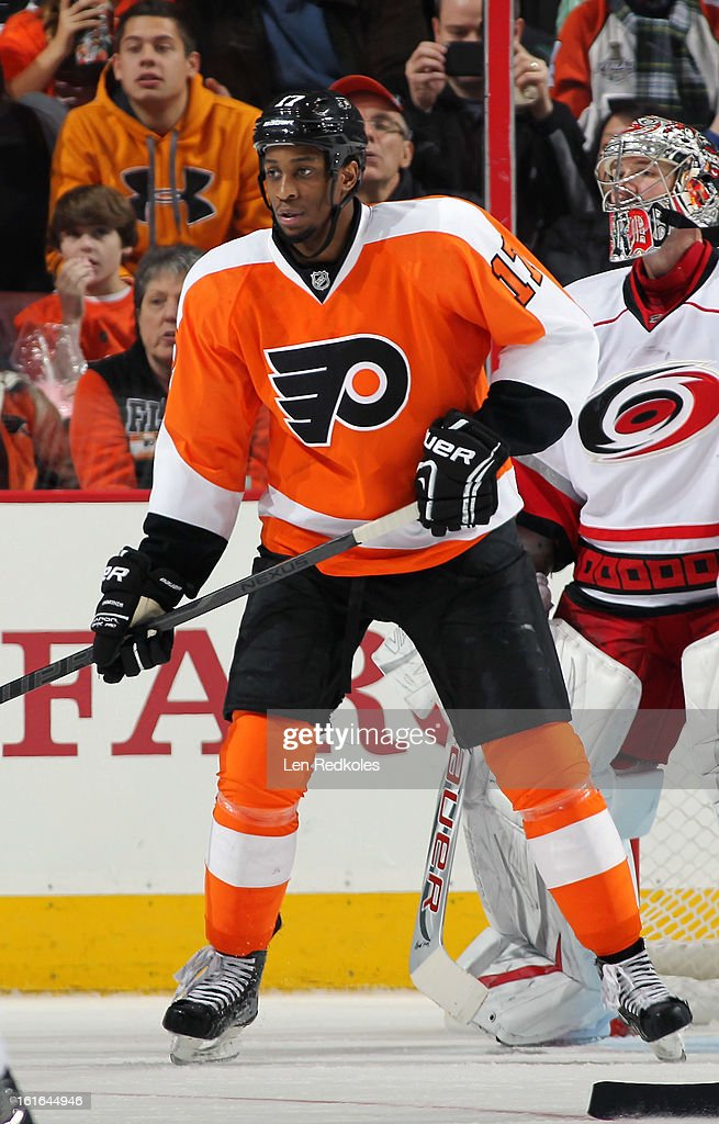 Wayne Simmonds #17 of the Philadelphia Flyers stands in the crease against Cam Ward #30 of the Carolina Hurricanes on February 9, 2013 at the Wells Fargo Center in Philadelphia, Pennsylvania.
