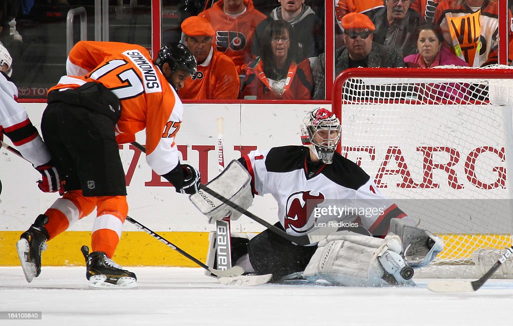 Wayne Simmonds #17 of the Philadelphia Flyers takes a shot on goaltender Johan Hedberg #1 of the New Jersey Devils on March 15, 2013 at the Wells Fargo Center in Philadelphia, Pennsylvania.