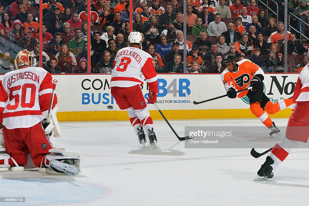 <a gi-track='captionPersonalityLinkClicked' href=/galleries/search?phrase=Wayne+Simmonds&family=editorial&specificpeople=4212617 ng-click='$event.stopPropagation()'>Wayne Simmonds</a> #17 of the Philadelphia Flyers takes a shot on <a gi-track='captionPersonalityLinkClicked' href=/galleries/search?phrase=Jonas+Gustavsson&family=editorial&specificpeople=886789 ng-click='$event.stopPropagation()'>Jonas Gustavsson</a> #50 of the Detroit Red Wings past <a gi-track='captionPersonalityLinkClicked' href=/galleries/search?phrase=Justin+Abdelkader&family=editorial&specificpeople=2271858 ng-click='$event.stopPropagation()'>Justin Abdelkader</a> #8 at the Wells Fargo Center on January 28, 2014 in Philadelphia, Pennsylvania.