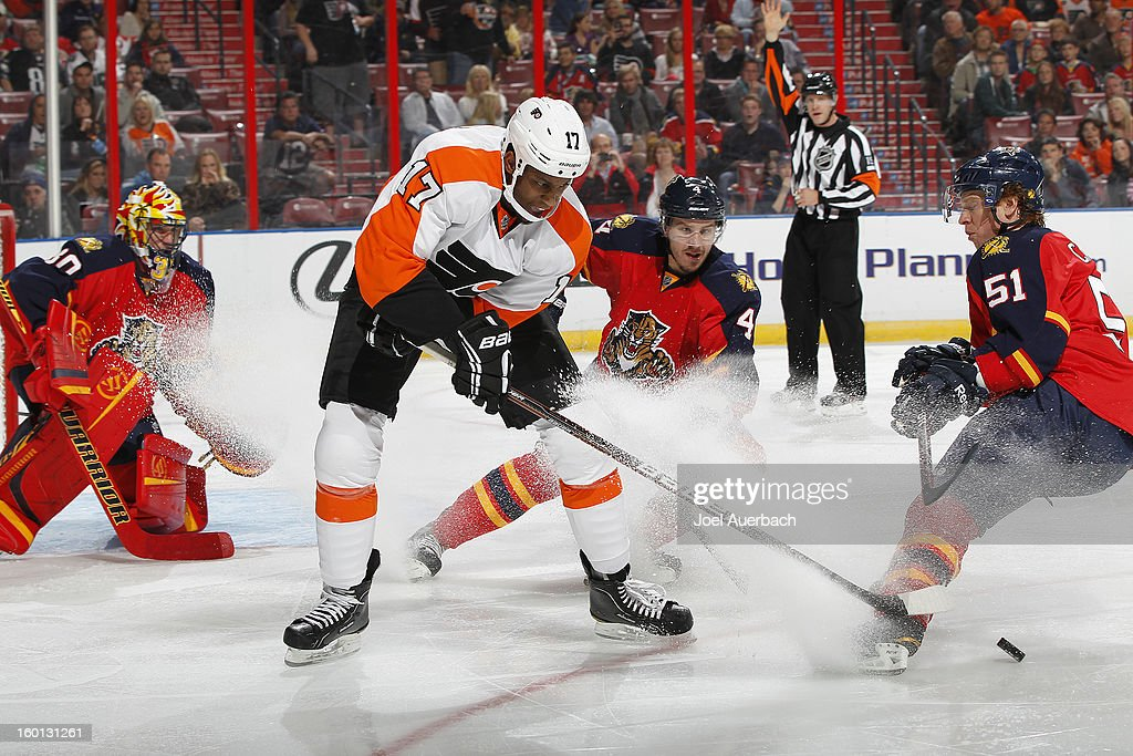 <a gi-track='captionPersonalityLinkClicked' href=/galleries/search?phrase=Wayne+Simmonds&family=editorial&specificpeople=4212617 ng-click='$event.stopPropagation()'>Wayne Simmonds</a> #17attempts to gain control of the pick on a delayed penalty call against the Philadelphia Flyers xx of the Florida Panthers at the BB&T Center on January 26, 2013 in Sunrise, Florida. The Flyers defeated the Panthers 7-1.