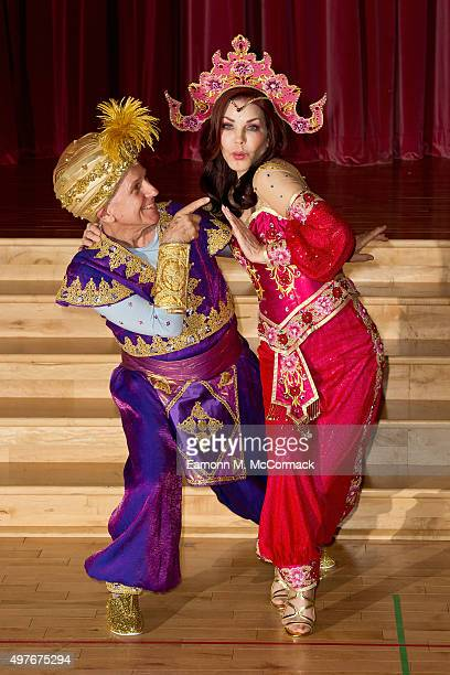 Wayne Sleep and Priscilla Presley pose during a photocall for 'Aladdin' at Milton Keynes Theatre on November 18 2015 in Milton Keynes England