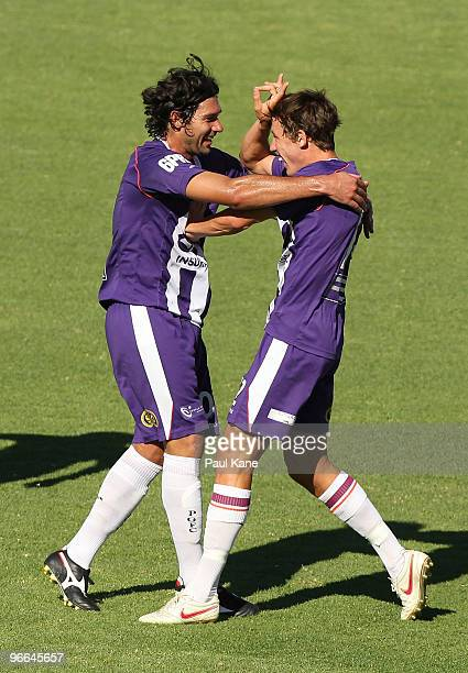 Wayne Srhoj and Scott Neville of the Glory celebrate a goal with team mates during the round 27 ALeague match between Perth Glory and Brisbane Roar...