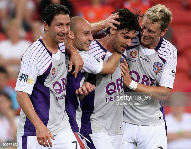 Wayne Srhoj of the Glory celebrates with team mates after scoring a goal during the round seven ALeague match between the Brisbane Roar and Perth...