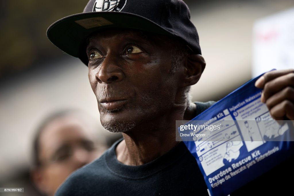 Wayne Starks, a former drug addict who has been clean for 17 years, holds up a naloxone (NARCAN) overdose kit while speaking during a protest denouncing the city's 'inadequate and wrongheaded response' to the overdose crisis, outside of the New York City Police Department (NYPD) headquarters, August 10, 2017 in New York City. The group is calling for a more public health focused approach and wants the 70 million dollars allocated to the city and NYPD's 'Healing NYC' program to be redirected to the Department Of Health and Mental Hygiene.