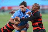 Wayne Stevens and Siyabonda Mangweni of Eastern Province Kings tackle Dries Swanepoel of Blue Bulls during the Vodacom Cup Quarter Final match...