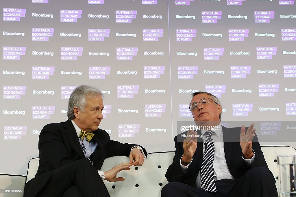 Wayne Swan, Australia's deputy prime minister and treasurer, right, speaks as Matthew Winkler, editor-in-chief at Bloomberg News, looks on during the Bloomberg Australia Economic Summit in Sydney, Australia, on Wednesday, April 10, 2013. Swan said he supports Federal Reserve Chairman Ben S. Bernanke's quantitative easing and Japanese Prime Minister Shinzo Abe's reflation policy, in contrast to Europe's hazardous pursuit of austerity as the world economy struggles to shake off the global financial crisis. Photographer: Brendon Thorne/Bloomberg via Getty Images