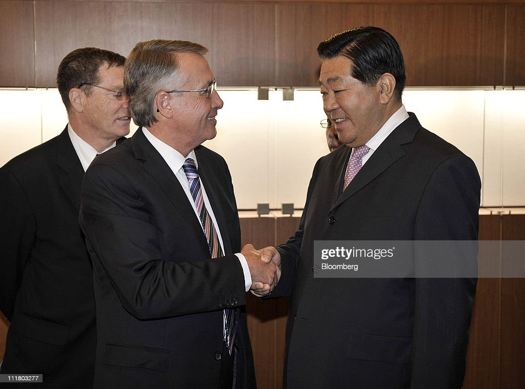 <a gi-track='captionPersonalityLinkClicked' href=/galleries/search?phrase=Wayne+Swan&family=editorial&specificpeople=4582809 ng-click='$event.stopPropagation()'>Wayne Swan</a>, Australia's treasurer, left, shakes hands with <a gi-track='captionPersonalityLinkClicked' href=/galleries/search?phrase=Jia+Qinglin&family=editorial&specificpeople=687988 ng-click='$event.stopPropagation()'>Jia Qinglin</a>, chairman of the Chinese People's Political Consultative Conference (CPPCC), before a private dinner at Parliament House in Canberra, Australia, on Thursday, April 7, 2011. Jia, a member of China's top decision-making body, today signed an agreement with Australian Prime Minister Julia Gillard to strengthen education ties and promote stronger co-operation. Photographer: Mark Graham/Bloomberg via Getty Images