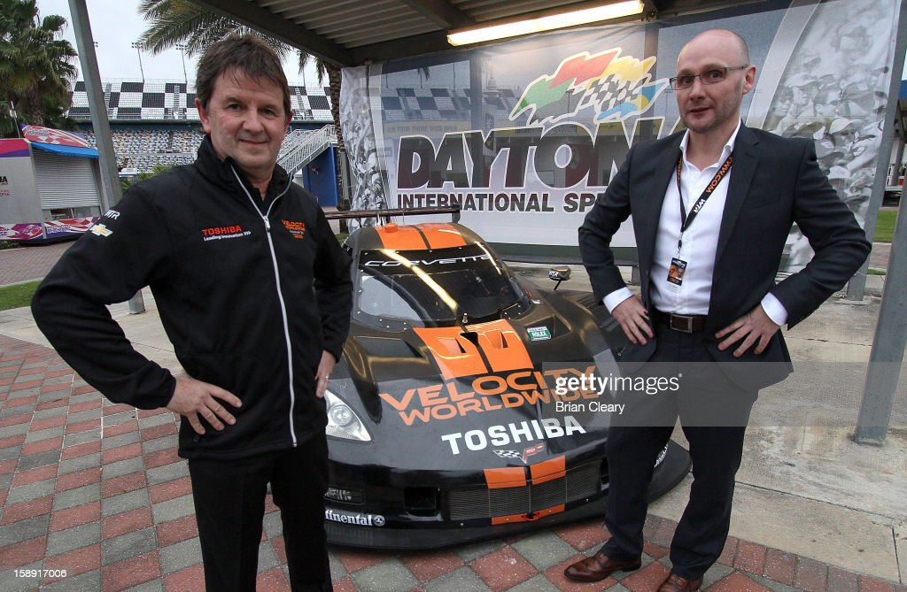 Wayne Taylor (L), owner of Wayne Taylor Racing and Paul Blakely, CEO Americas of Velocity Worldwide, pose with the #10 Wayne Taylor Racing Velocity Worldwide Corvette Dallara DP at Daytona International Speedway on January 3, 2013 in Daytona Beach, Florida.