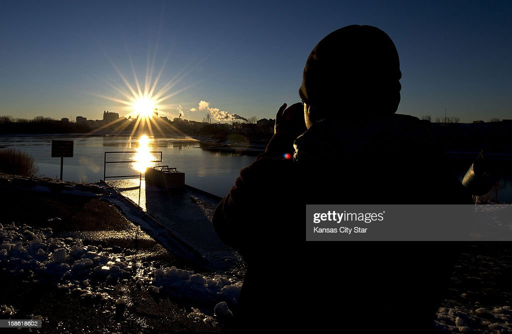 Wayne Yang photographed the sun rising over Kansas City from Kaw Point in Kansas City, Kansas, on the last day of the Mayan Calendar, Friday, December 21, 2012. Yang has wanted to photograph the sunrise to update his web page, and happened to choose this morning to take his photograph.