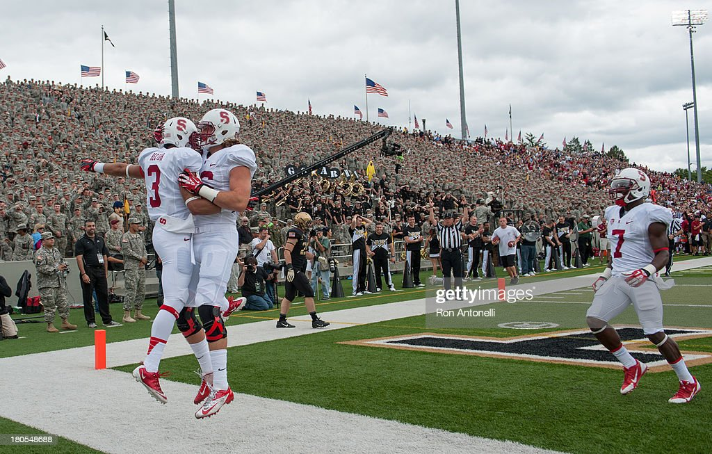 Wde receiver Michael Rector #3 of Stanford celebrates with tight end Charlie Hopkins #86 after Rector's touchdown catch in the 1st half September 14, 2013 at Michie Stadium in West Point, New York. . Stanford defeated Army 24-20.