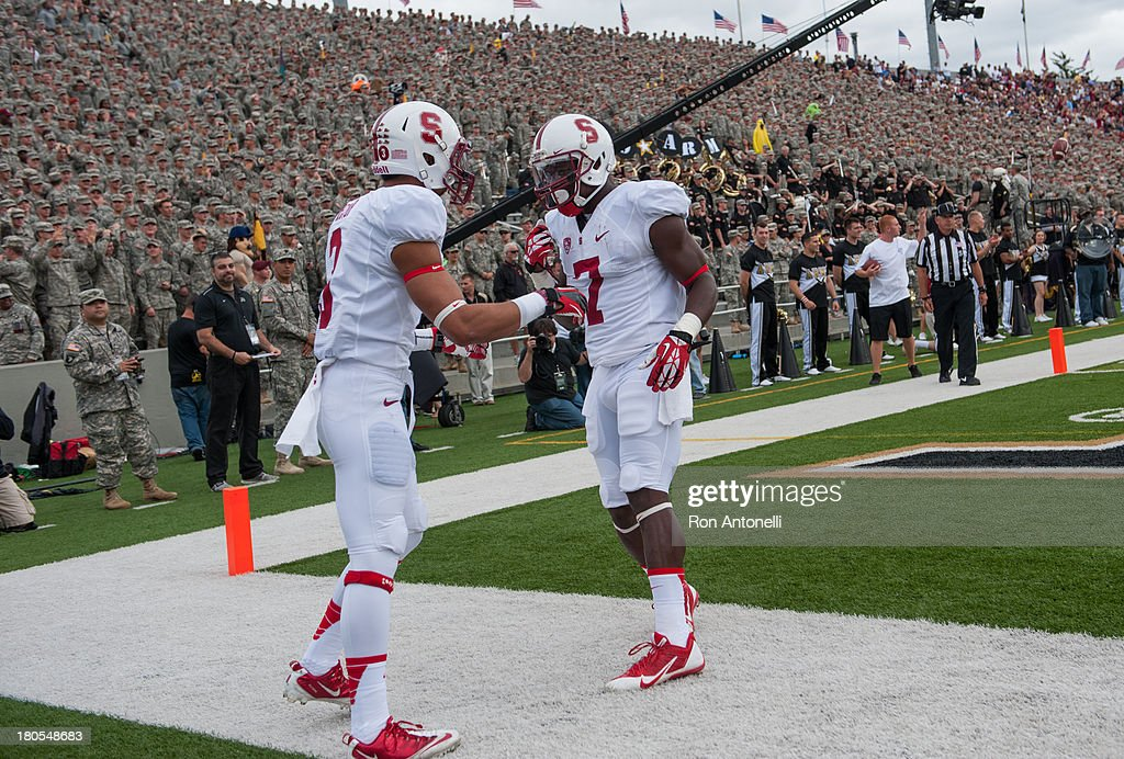 Wde receiver Michael Rector #3 of Stanford celebrates with wide receiver <a gi-track='captionPersonalityLinkClicked' href=/galleries/search?phrase=Ty+Montgomery&family=editorial&specificpeople=8572442 ng-click='$event.stopPropagation()'>Ty Montgomery</a> #7 of Stanford after Rector's touchdown catch in the 1st half September 14, 2013 at Michie Stadium in West Point, New York. . Stanford defeated Army 24-20.