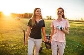 Two women walking on the golf coarse