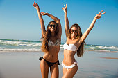 Beautiful girls in a summer day having fun on the beach