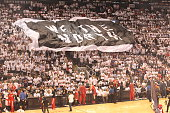 We the North flag is passed around the arena before Washington Wizards faces of with the Toronto Raptors Game One of the Eastern Conference...