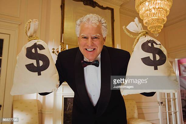 Wealthy man with money bags