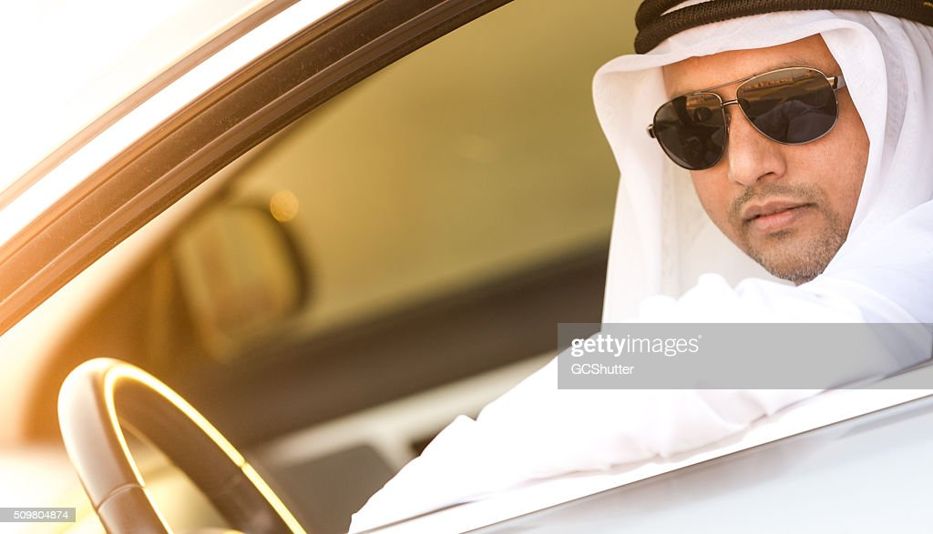 Wealthy Middle Eastern Arab in his Luxury Car