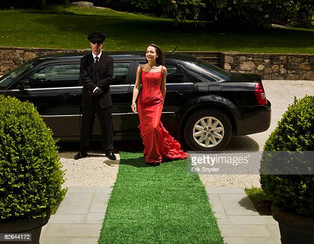 Wealthy woman in designer gown.