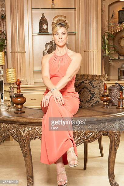 Wealthy Woman Sitting on Desk