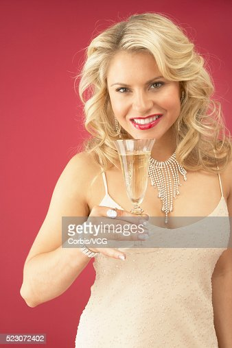 Wealthy Young Woman Holding Champagne Glass