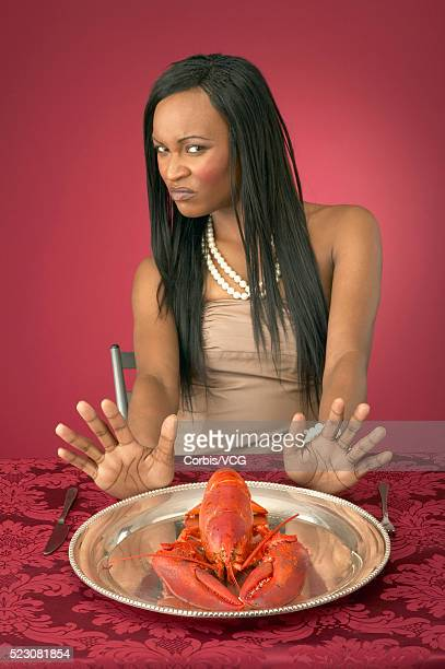 Wealthy Young Woman Refusing Lobster