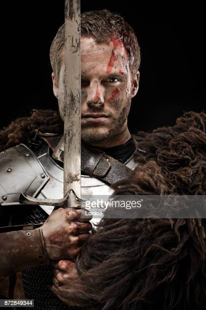 Weapon wielding dirty bloody viking warrior in emotional pose
