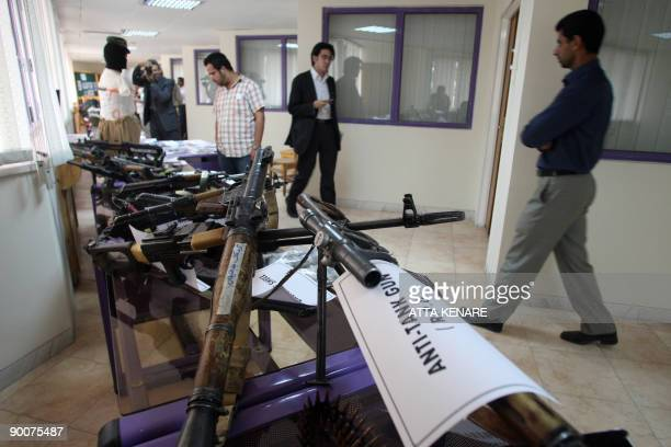 Weapons allegedly confiscated from the Jundallah Sunni rebel group are displayed at a government building in Iran�s restive southeastern city of...