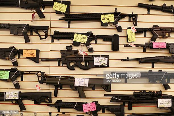 Weapons are seen on display at the KW Gunworks store on the day that US President Barack Obama in Washington DC announced his executive action on...