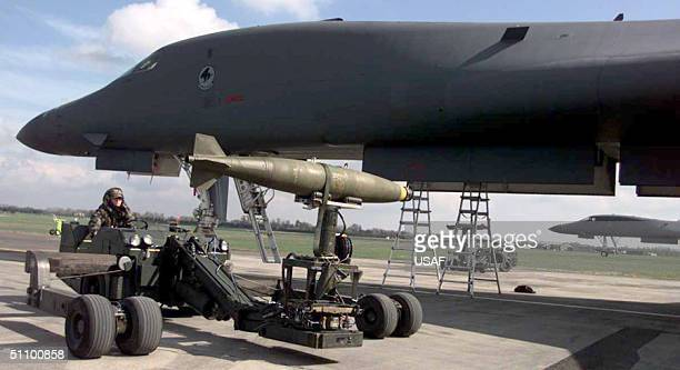 A Weapons Loader Transports A Bomb For Loading On A B1 Bomber April 4 1999 Personnel From The 2Nd Bomb Wing Have Deployed To England As Part Of The...