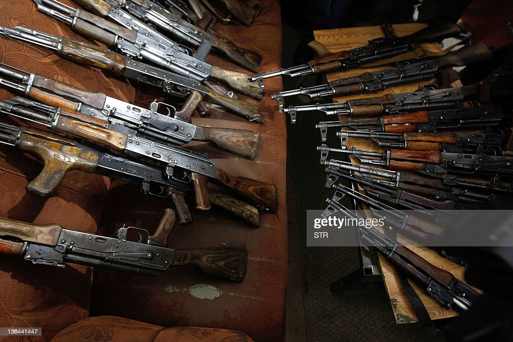 AK47 weapons seized from two Britons along with their driver and interpreter are presented to the media in Kabul on January 5 2012 Two British men...