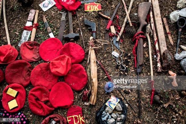 Weapons used by alleged attackers are displayed at police headquarters in Kinshasa on August 8 a day after twelve people were killed by stray gunfire...