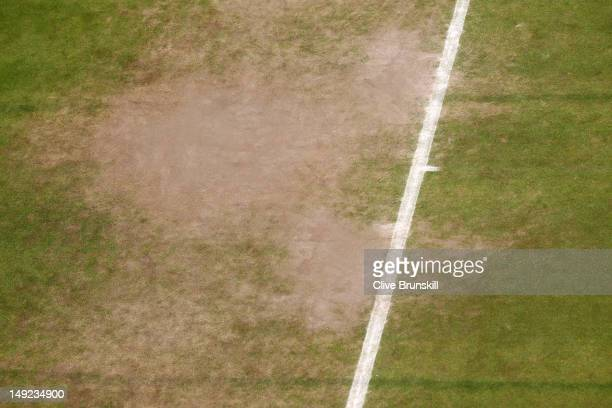 Wear on the baseline is evident during a practice session ahead of the 2012 London Olympic Games at the All England Lawn Tennis and Croquet Club in...