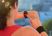 Woman using smart watch before exercising.