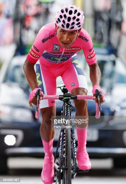 Wearer of the Maglia Rosa leader's jersey Nairo Quintana of Colombia and team Movistar sprints for the finish line during the nineteenth stage of the...