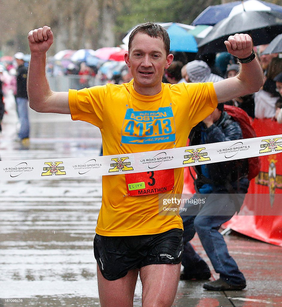 Wearing a 4-15-13 Boston Marathon shirt, Bryant Jensen wins the Salt Lake City Marathon on April 20, 2013 in Salt Lake City, Utah. The shirt was created to honor those killed or injured in the Boston Marathon bombing and also for those that were unable to finish the race. Due to the bombings at the Boston Marathon on April 15, security was dramatically increased by law enforcement and Utah National Guard at the Salt Lake City Marathon. Organizers are asking spectators to leave backpacks at home.