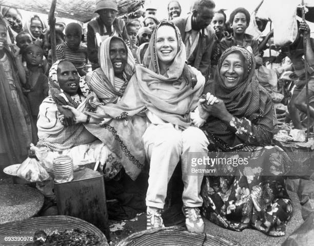 Wearing a bridal vail their gift Liv Ullman sits with women at a refugee camp in the Ogaden region of Ethiopia Refugees there were forced from their...