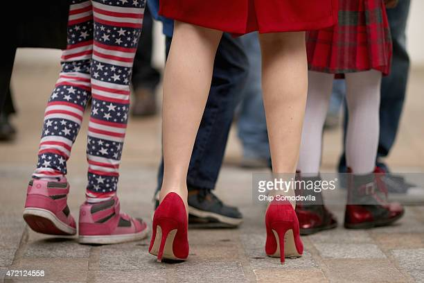 Wearing a bright red dress and shoes First Minister and leader of the Scottish National Party Nicola Sturgeon meets members of the public while...