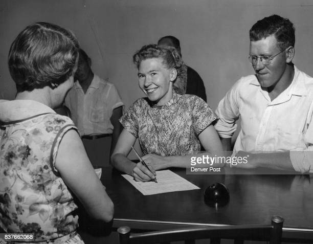 Wearing a bright smile as she signs the bond releasing her from jail in Brighton Friday j Mrs Nola Kathleen Rogers will present motions Aug 15 for a...