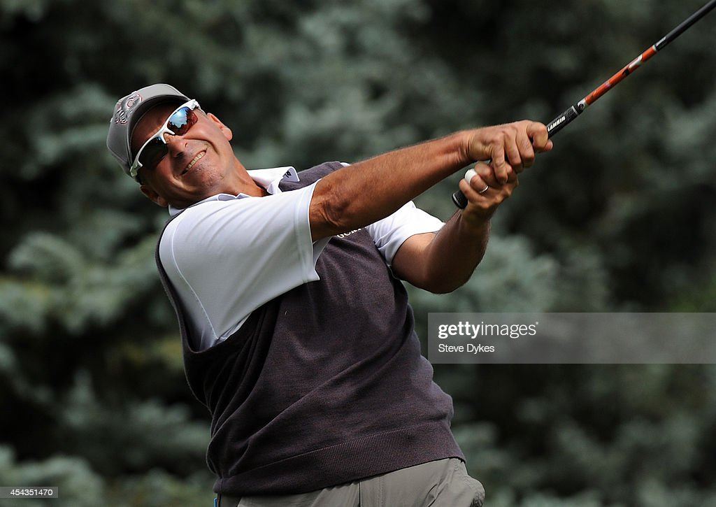 Wearing a Calgary Flames hat, defending champion Rocco Mediate hits his drive on the fourth hole during the first round of the Shaw Charity Classic on August 29, 2014 in Calgary, Canada.