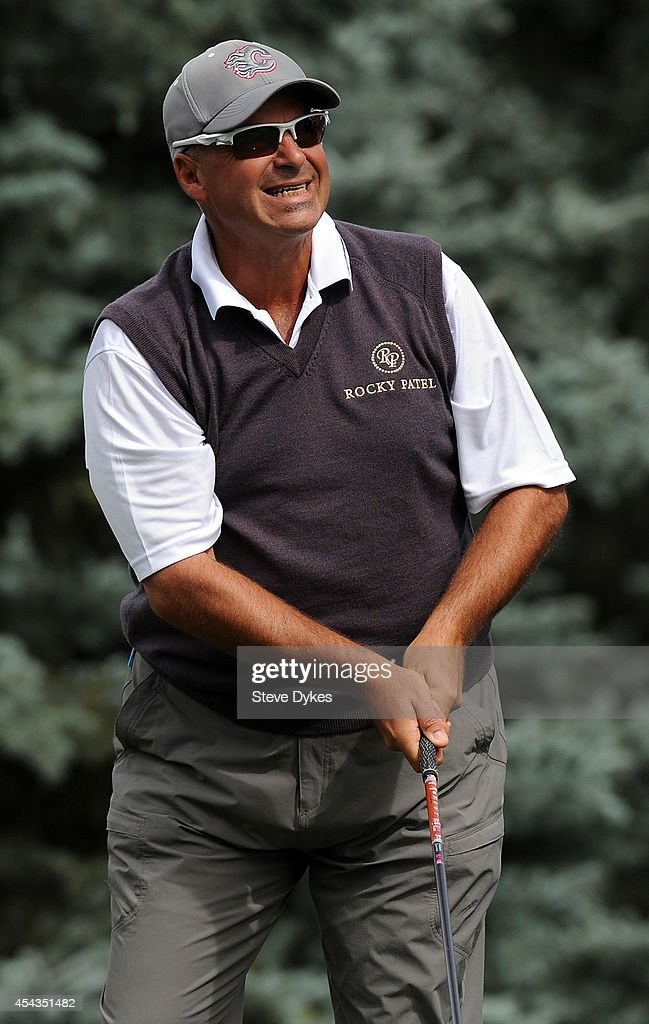 Wearing a Calgary Flames hat, defending champion Rocco Mediate watches his drive on the fourth hole during the first round of the Shaw Charity Classic on August 29, 2014 in Calgary, Canada.
