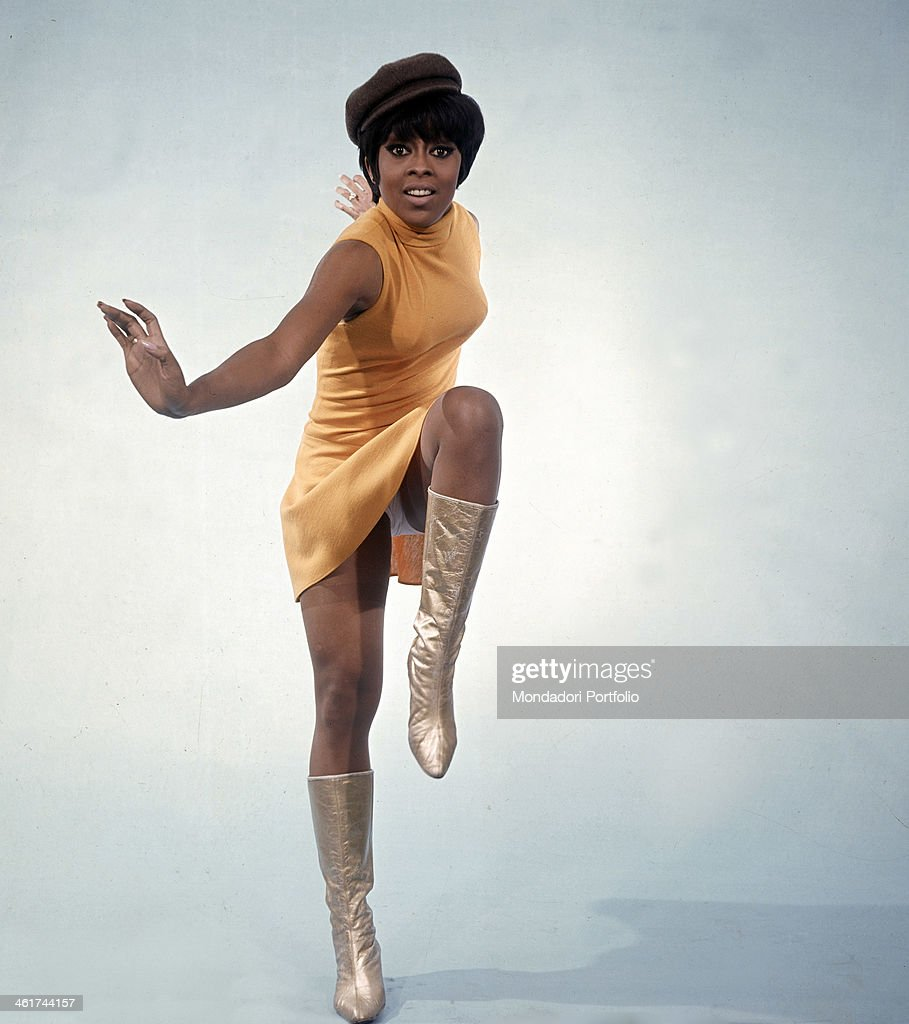 Wearing a close-fitting dress, a hat and gilded boots, the lively American show girl Lola Falana, born Loletha Elaine Falana, extemporizes a dance step; after the debut in Broadway, in the Sixties she became a star of the Italian televisione, where she often danced in Don Lurio's company. Italy, 1967.