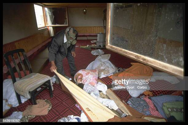 Wearing a mask to help prevent the spread of disease a man discovers the body of a victim killed in Kosovo during the Yugoslavian Civil War In the...