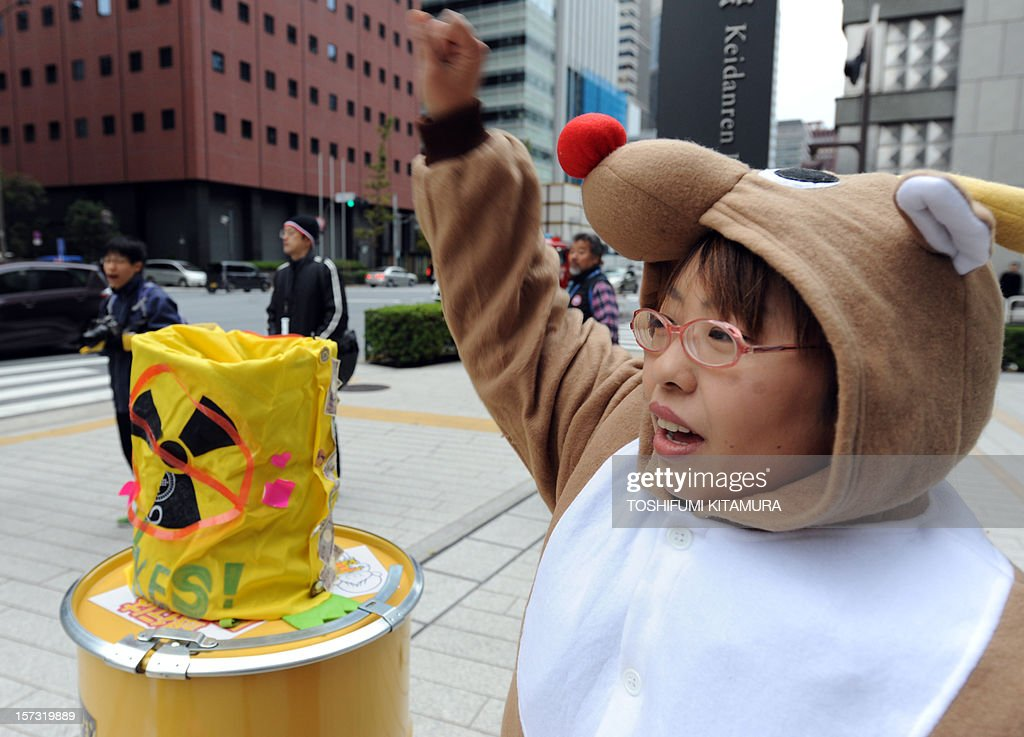 Wearing a reindeer costume, a protester shouts during an anti-nuclear power plant demonstration outside the Keidanren (Japan Business Federation) headquarters in central Tokyo on December 2, 2012. Protesters were demanding that Japan's economic leaders not support the re-starting of the country's nuclear power plants.