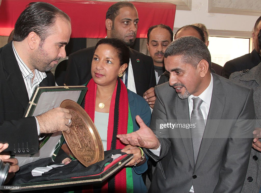 Wearing a scarf in the colours of the Libyan flag, visiting U.S. Ambassador to the United Nations Susan Rice is presented with a memento during her visit to the eastern Libyan city of Benghazi, on November 22, 2011.