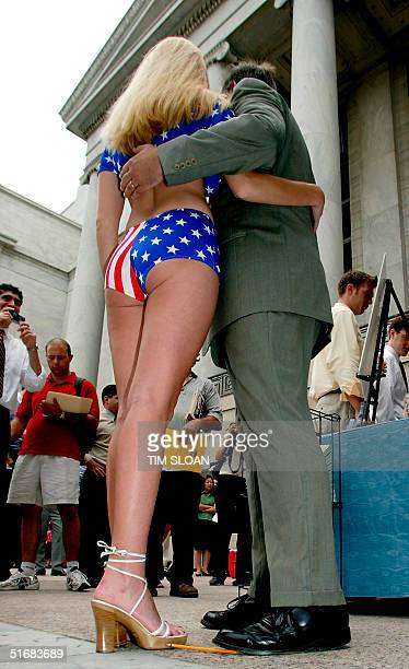 Wearing a starsandstripes bikini Playboy magazine's Miss July 2002 vegetarian Lauren Anderson poses for pictures and autographs with legislators and...