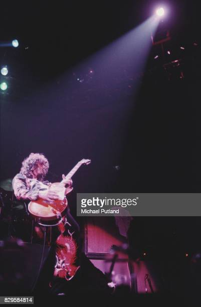 Wearing a suit decorated with oriental dragon motifs English guitarist Jimmy Page performs at Earl's Court playing a Gibson Les Paul guitar London...