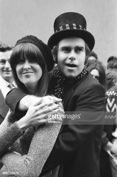 Wearing a top hat Elton John at a small studio in Ladbroke Grove to make a promotional film for his new single Giving the film the feeling of the...