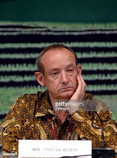 Wearing a traditional batik shirt UN Framework Convention on Climate Change Executive Secretary Yvo de Boer listens to a question during a press...